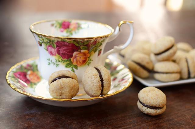 Nocciola Baci (Baci di Dama or Hazelnut Kisses) - ButterYum. how to make baci di dama cookies. italian hazelnut cookies. italian baci cookies. how to make baci cookies. baci recipe. italian lady kisses. Italian lady kiss cookies. baci cookie recipe. David Lebovitz baci di dame cookies.