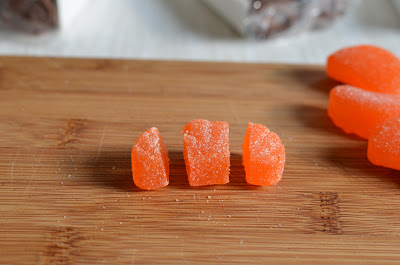 Cut the sugared orange slices in thirds like this.  Buy lots of extras for snacking.