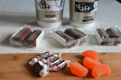 You'll need Swiss cake rolls, tootsie rolls, sugared orange slices, white fondant, and black fondant (Duff Goldman Buttercream Fondant tastes great!).  Better get a little extra of everything - you know, for snacking.