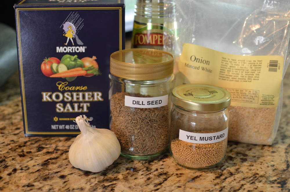 Boil the ingredients for the pickle brine.  A note about mustard and dill seeds - the most inexpensive place I've found them is at my local Hispanic grocery store.  I got a large bag of each for less than $3.  Also check out Asian and Indian markets.