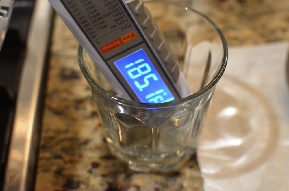 My thermometer kept falling over so I propped it up in a glass.     When the temperature reaches 185F, turn off the heat.