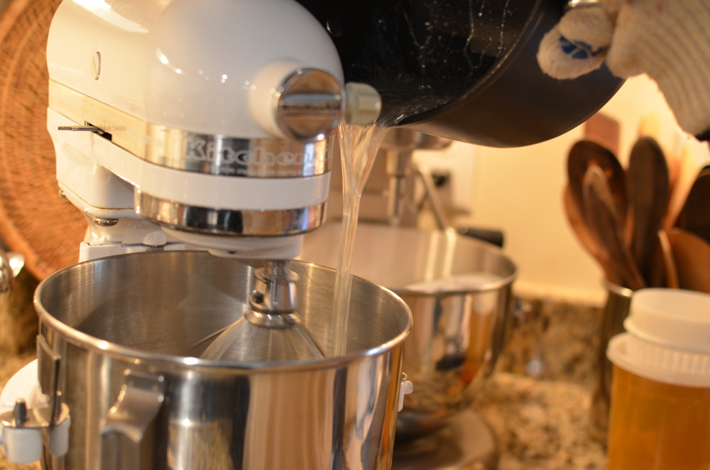 Immediately turn the stand mixer on low speed and pour the hot sugar syrup into the gelatin mixture.