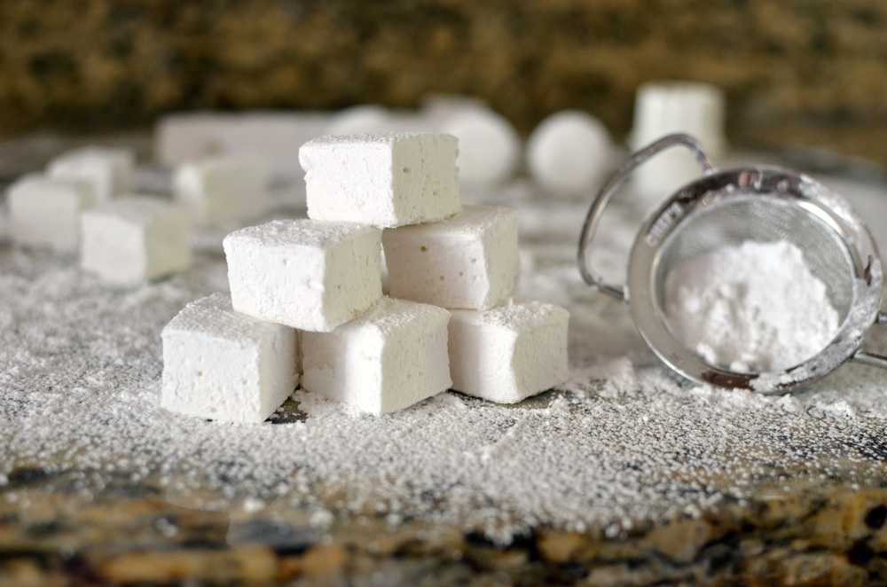 When marshmallows are completely set, dust very well with confectioners' sugar, cut, and toss with more confectioners' sugar. Store in an airtight container.