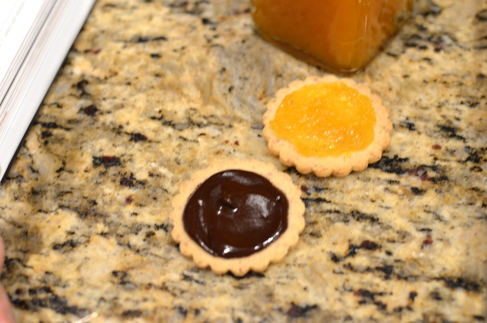 Repeat the process with a second almond cookie, only this time add a puddle of chocolate ganache.