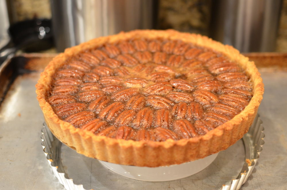 To unmold, elevate the tart on an inverted bowl and let the tart ring slip right off.