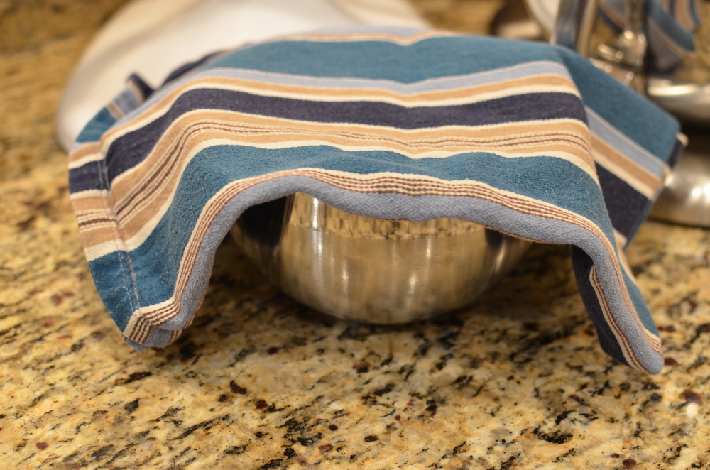Cover bowl with a clean kitchen towel and set aside for at least 8 hours (can be up to 72 hours).  DO NOT cover the bowl with plastic wrap as condensation will form and drip into the mixture, causing the chocolate to seize (turn grainy and lumpy).