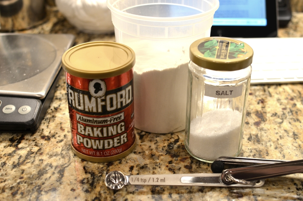 Okay, for the crust we start by chilling flour, baking powder, and salt.  To make this crust by hand, put the chilled the flour, baking powder, and salt in a mixing bowl and add the cream cheese.