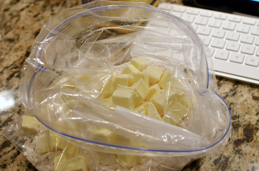 Add cubed butter that has been chilling in the freezer for 30 minutes.  Hard 1/2-inch cubes of frozen butter.
