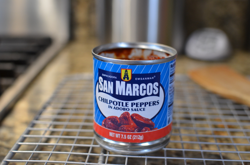 Next add an entire 7.5 ounce can of chipotle peppers in adobo sauce.