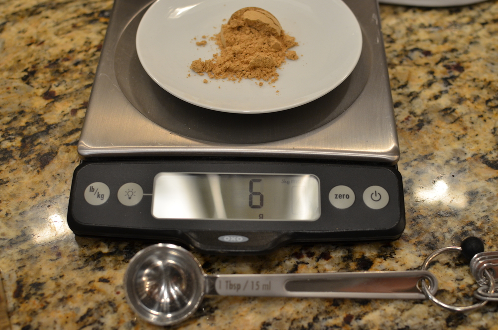 Weigh out 1 tablespoon of ground ginger, which should equal 6 grams (not 3 as the book states). Make a note in your book.