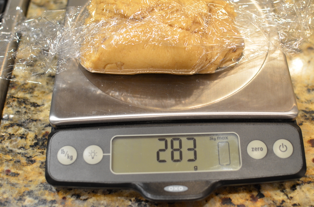 Divide the dough into 3 equal portions. Each should weigh approx 10 ounces or 283 grams.