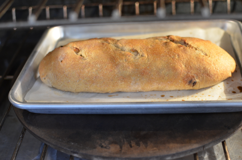 Then pop the loaf into the screaming hot oven, toss the ice cubes into the pan on the oven floor, and quickly close the oven door.  Bake for 5 minutes, then lower the heat to 400F and continue baking for 30-40 minutes.