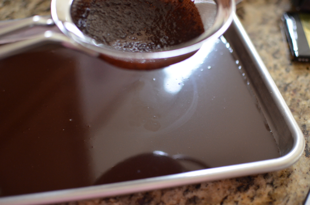 Pour the ganache through a  sieve  and allow it to cool at room for 3-4 hours until it reaches the consistency of frosting.
