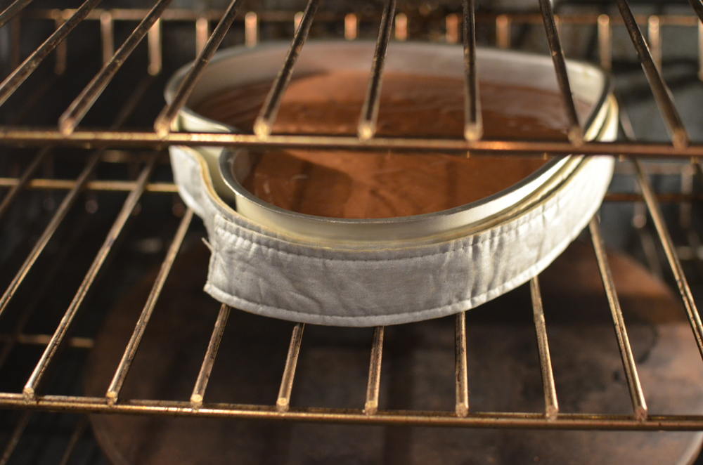 Don't forget to wrap the pan with  insulated cake strips  - they really eliminate a hump from forming as the cake bakes.