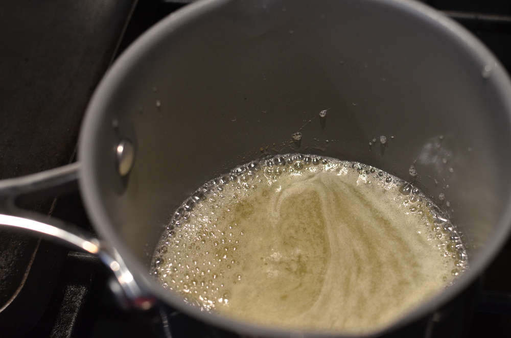 Right about the time the cream is ready, the lemon/sugar should just be reaching the boiling point.  Turn off the heat.