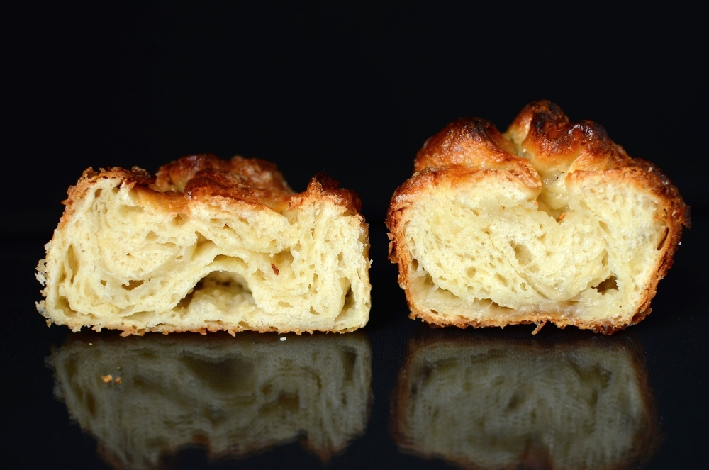 On the left, Kouigns Amann baked in a pastry ring.  On the right, Kouigns Amann baked in a Texas muffin pan.