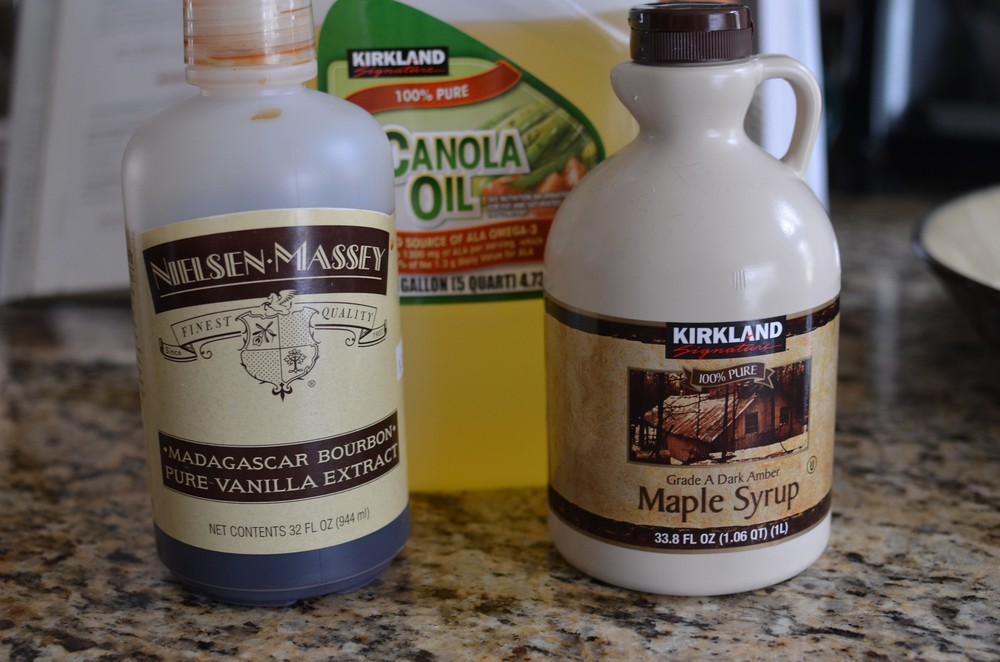 Next we're going to add the liquid ingredients - canola oil, pure maple syrup, and really good vanilla extract.
