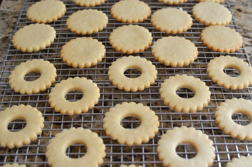 Allow the baked cookies to cool completely before filling with jam, buttercream, or lemon curd.   IMPORTANT - I forgot to mention that I always chill my cutouts for a few minutes before baking.  I think it helps to keep them from spreading too much during the baking process.