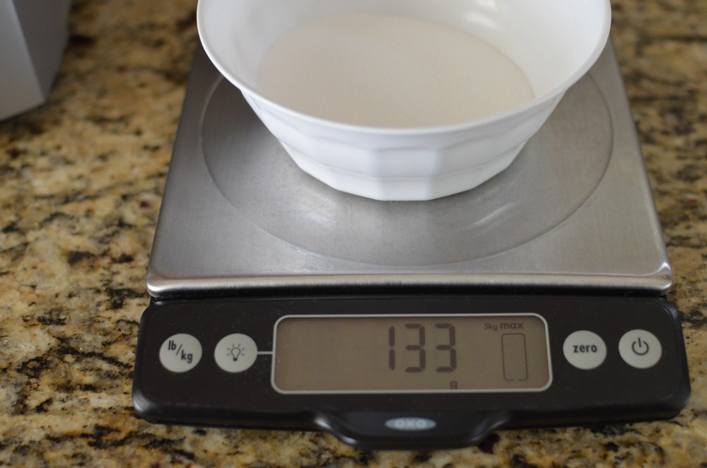 Start by weighing granulated sugar.  Weighing is the most accurate way to measure ingredients.
