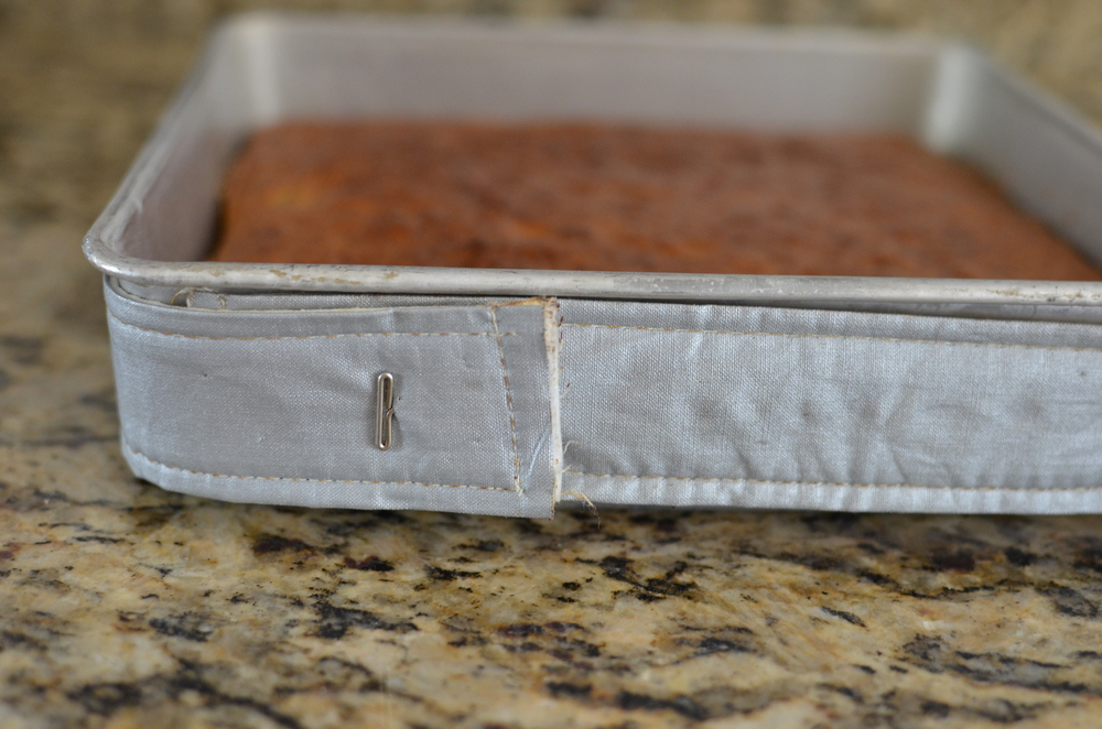 See how nice and even the insulated baking strips made the cake?  No hump!!  Happy-Happy.