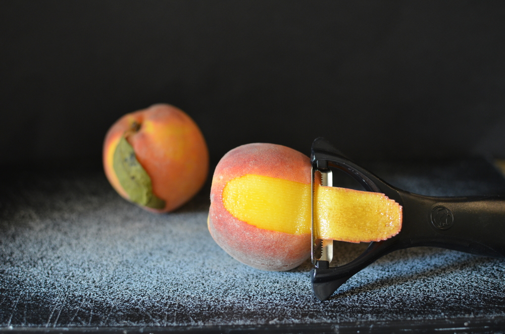 To make the best peach cobbler, you need to start with the best peaches you can get your hands on.  Peel them any way you like.  I like to use a serrated peeler, but if you like to use the boiling water method, feel free.