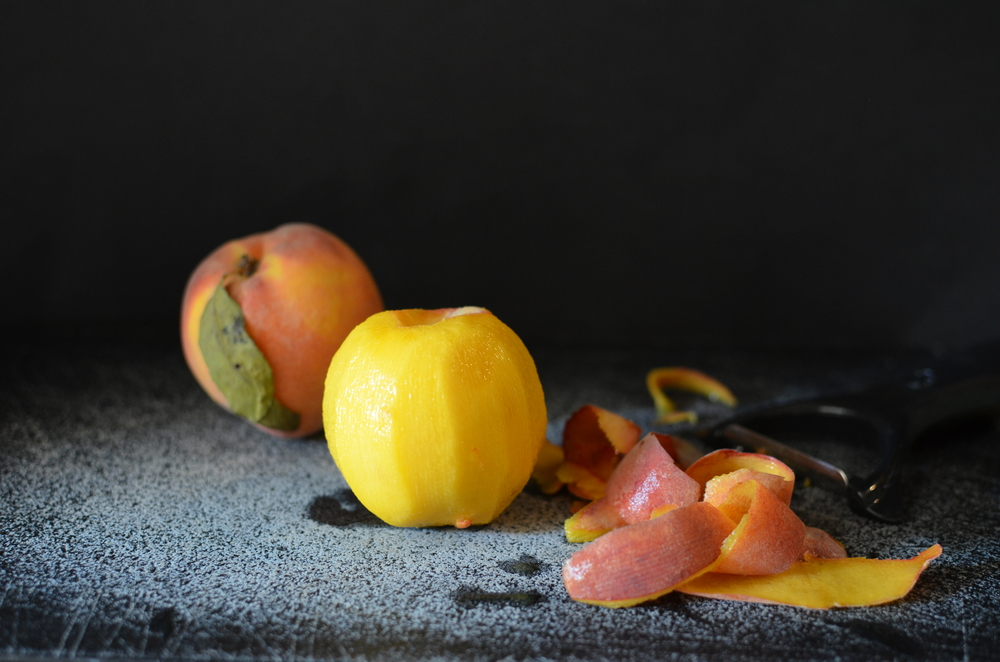 When all the skins are off your peaches, remove the pits and slice the peaches into 1/4-inch slices.