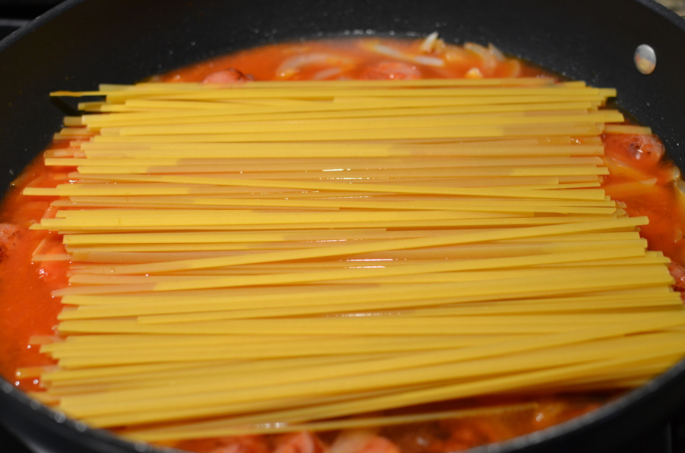 Add 1 pound of dry fettuccini. Be sure to use fettuccine - other pasta would require a different amount of water and I haven't had time to experiment.