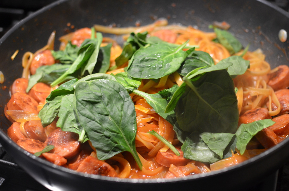 Turn off the heat and stir in a handful of fresh spinach.