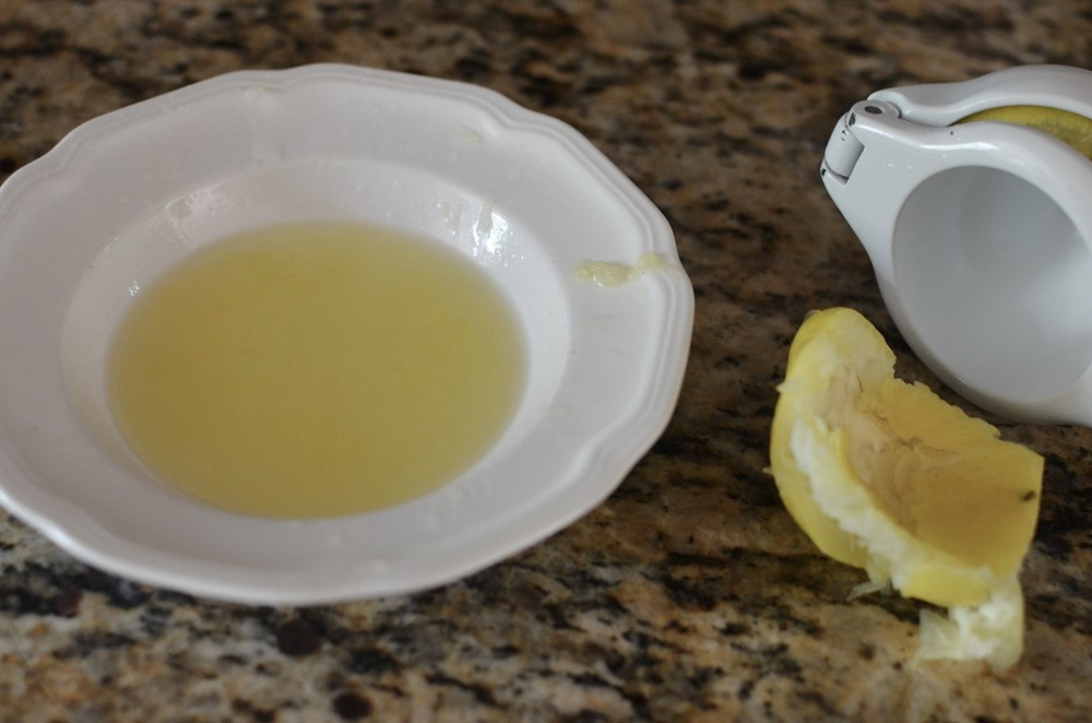 Then I used a citrus squeezer to get all the juice out of one lemon. By the way, room temperature or warm lemons give up more juice than cold lemons. Zap your lemon in the microwave for about 10 seconds if needed.