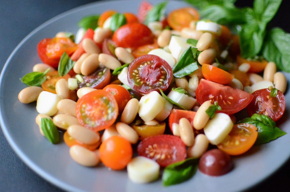 Caprese Bean Salad - ButterYum. a dressed up caprese salad. a twist on caprese salad. caprese salad with cherry tomatoes. caprese salad with grape tomatoes.