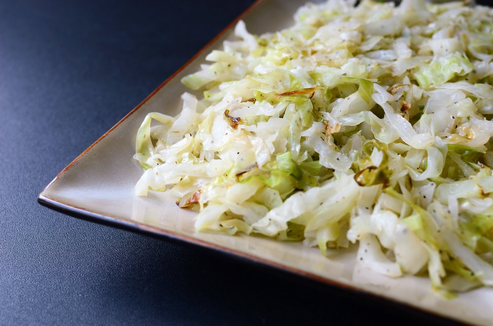 Butter Braised Cabbage - ButterYum.  braised cabbage recipe.  how to cook cabbage.  what to do with cabbage.  butter fried cabbage recipe.  how to cook shredded cabbage.  what to do with shredded cabbage.  St. Patrick's Day cabbage recipe.  Cabbage for St. Patrick's Day.