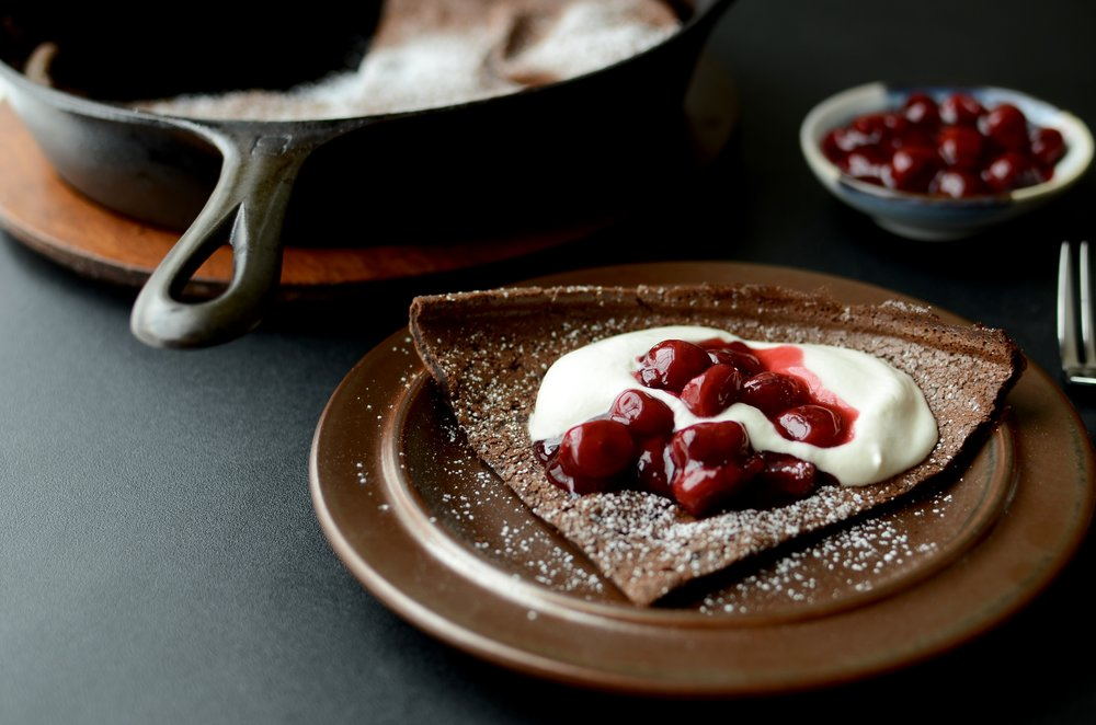 Black Forest Dutch Baby - ButterYum. how to make a chocolate dutch baby. Chocolate dutch baby recipe. chocolate German pancake recipe. recipe for dutch baby or German pancake. Black Forest desserts that aren't cake.