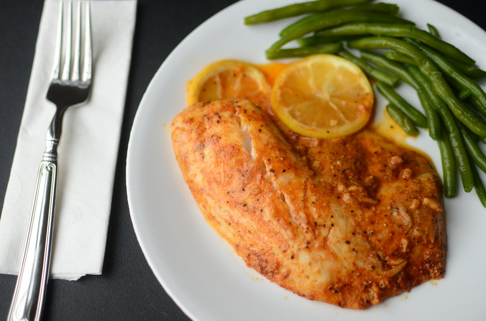 Oven baked tilapia recipes. tilapia with garlic and lemon. how to cook tilapia. tilapia recipes.