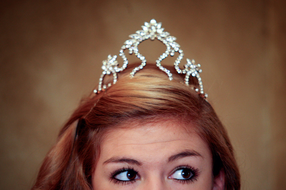 Junior Miss Victoria Emilia Ureste, 15, wears her crown in public for the first time while volunteering with the rest of the 2011 Miss Victoria Court at the Dorothy O'Connor Pet Adoption Center fundraiser at the Spring Creek Place Event Center in Victoria, Texas on Thursday, Sept. 8, 2011.
