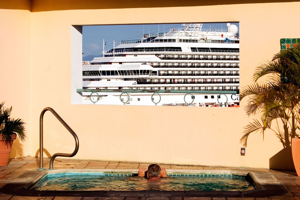 A large Carnival cruise ship can be clearly seen from the ninth floor of the Sheraton Hotel in San Juan, Puerto Rico, on Monday, June 22, 2009. It is estimated passengers on cruises spend $1.5 billion in Caribbean ports each year.