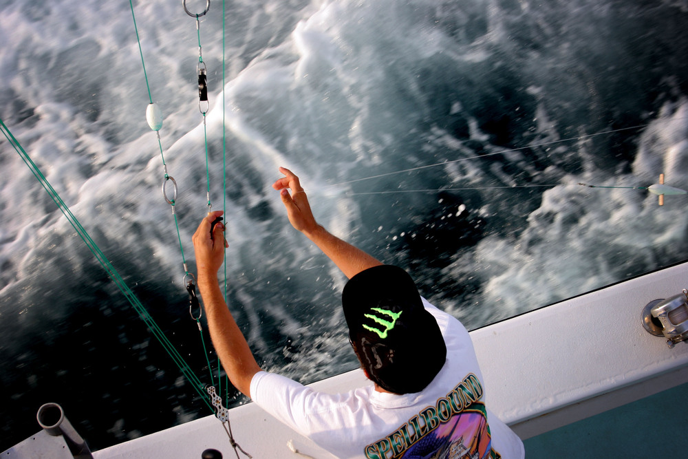 Chad Raney, 20, preps a line as the charter fishing boat.