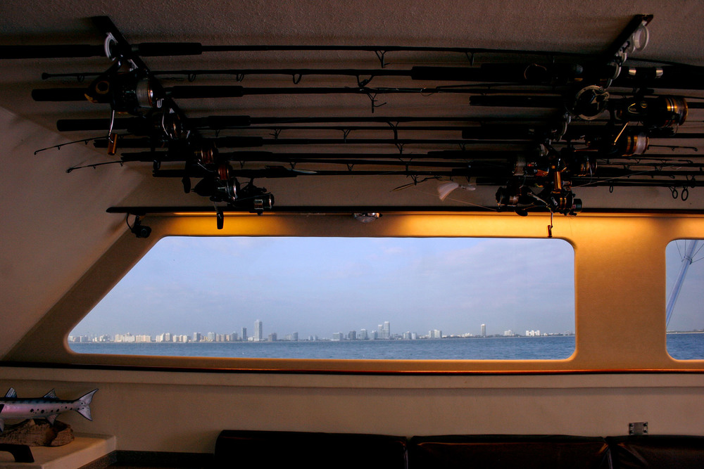 The Miami skyline can be seen from the charter fishing boat, Spellbound, off the coast of Miami Beach, Fla.