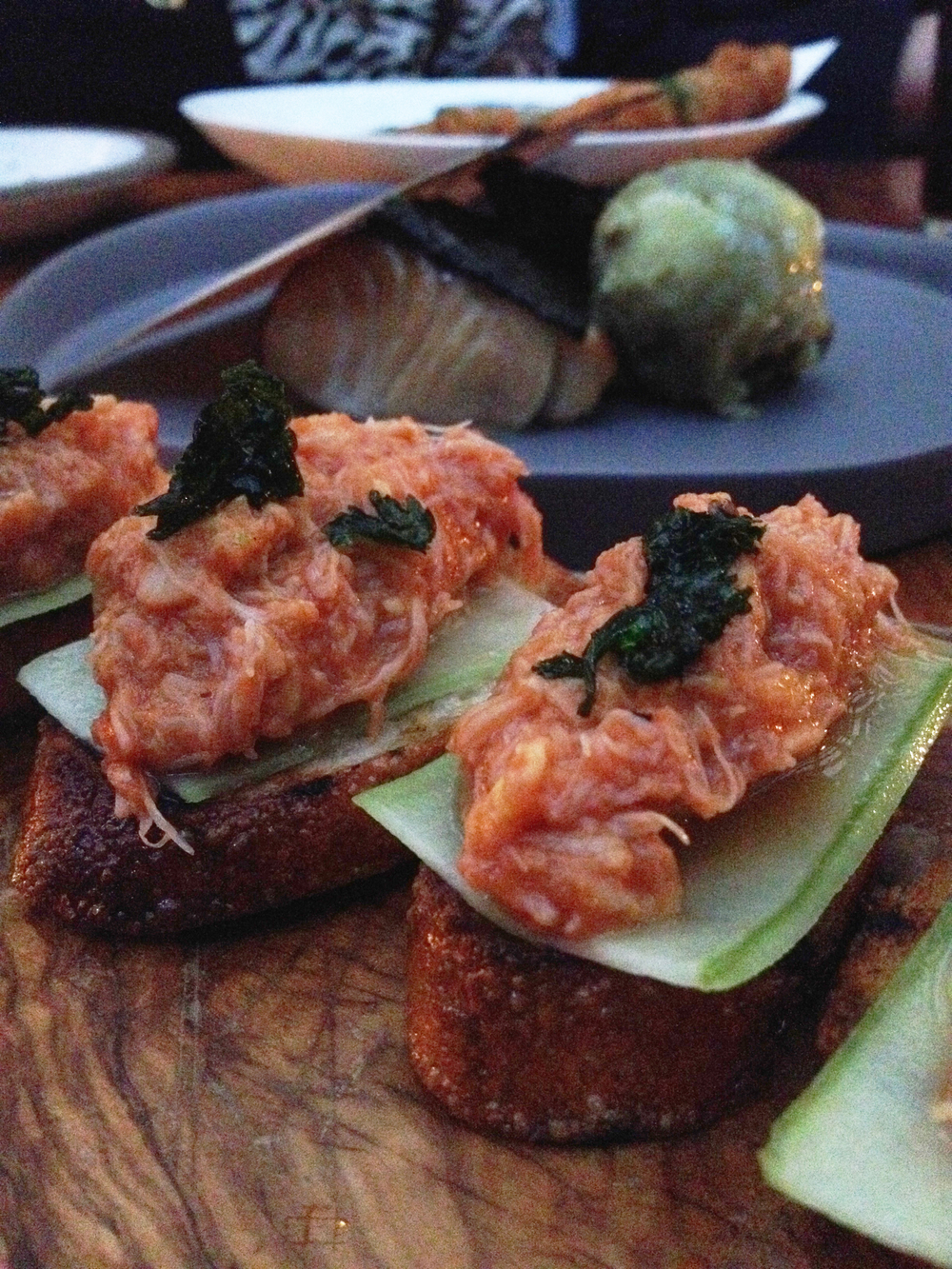 Chili crab toast, spicy cucumber, coriander (behind is the Hinoki-scented black cod with sweet potato and pistachio)
