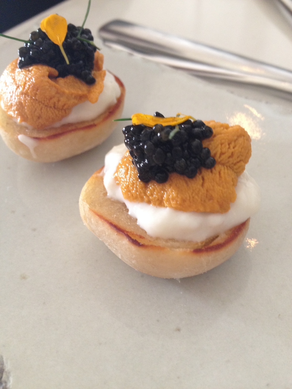 English muffin with uni,  crème   fraiche, and caviar.