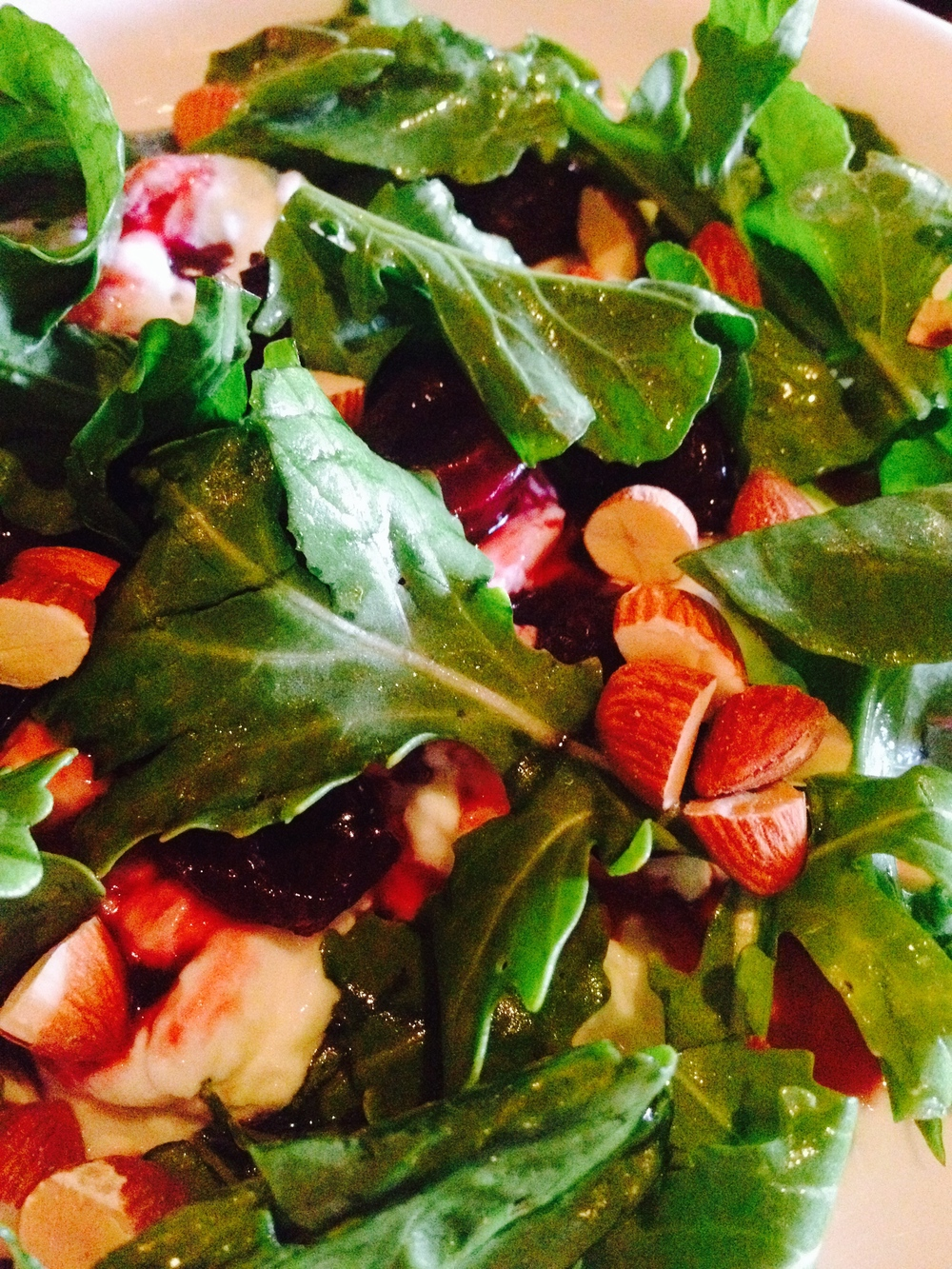 Balsamic roasted cherries, burrata, toasted almonds, and arugula.