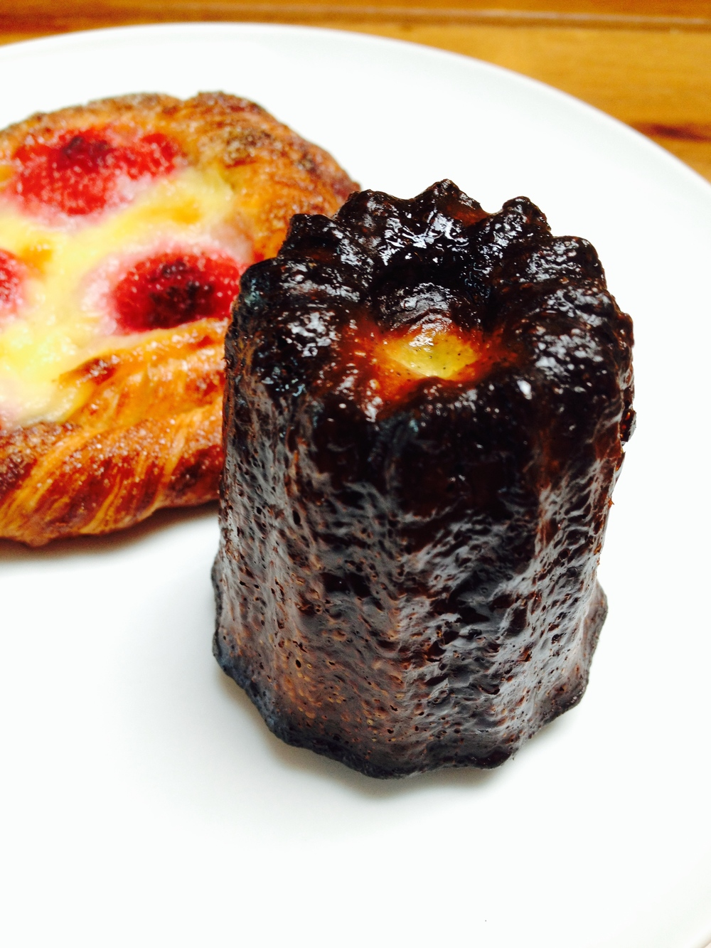 The most amazing canelé, plus a Cinnamon Twirl with raspberries.
