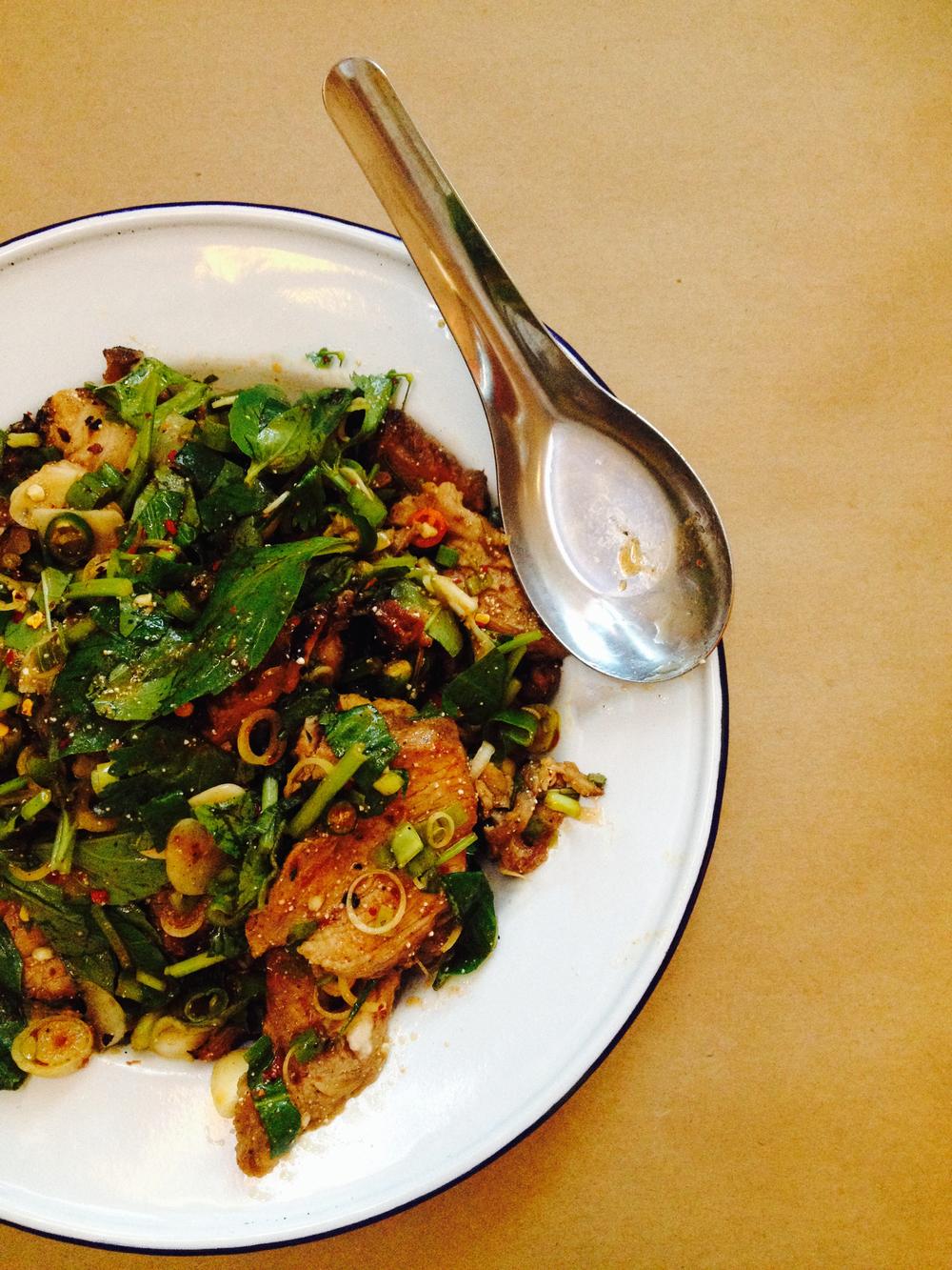 moo sadoong, or 'startled pig,' with grilled pork, basil, lemongrass, raw garlic, fish sauce, lime, chile