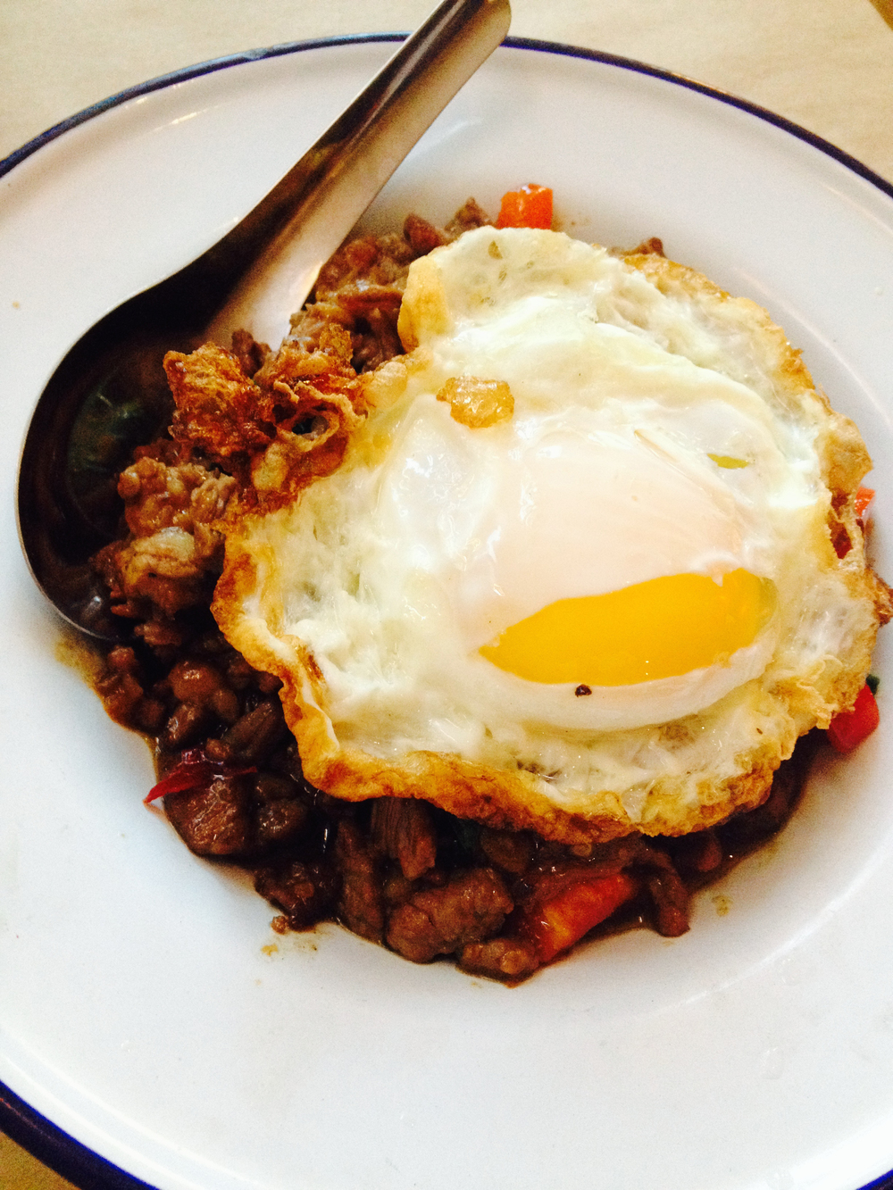 beef grapow with chile, garlic, thai basil. topped with a crispy fried egg