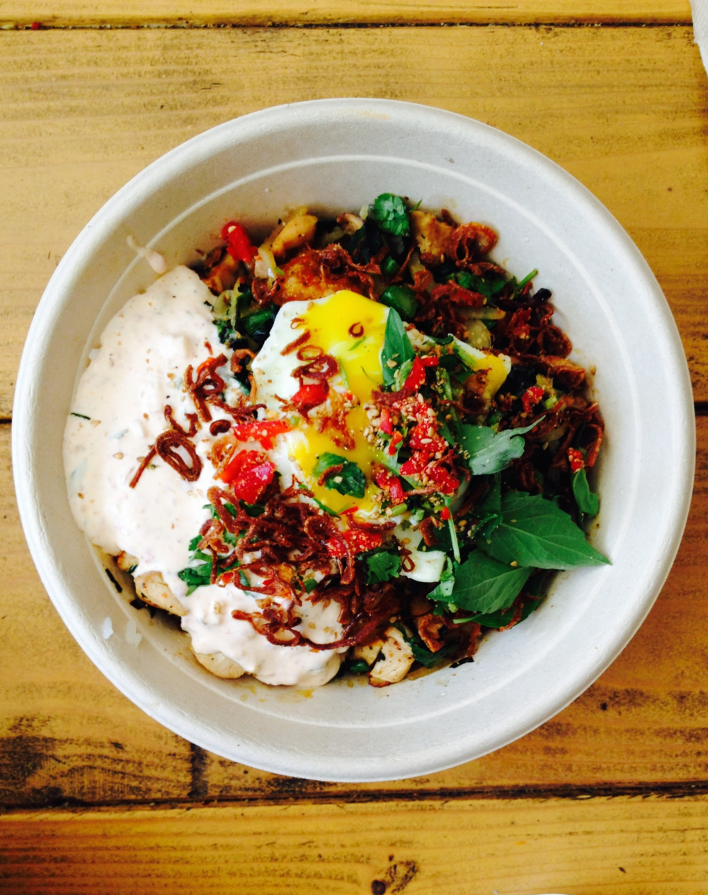 Sour Cream Hen House - marinated grilled chicken rice bowl with fried egg, Chinese broccoli, sour cream sambal, Thai basil, toasted sesame, and red jalapeño.