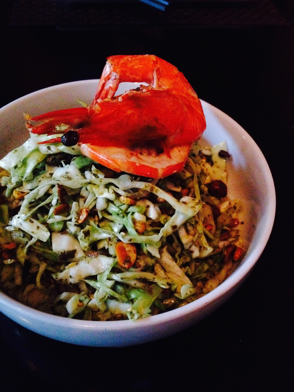 Tea Leaf Salad with cabbage, crispy chana dal, marcona almonds, peanuts, sesame, and prawns.