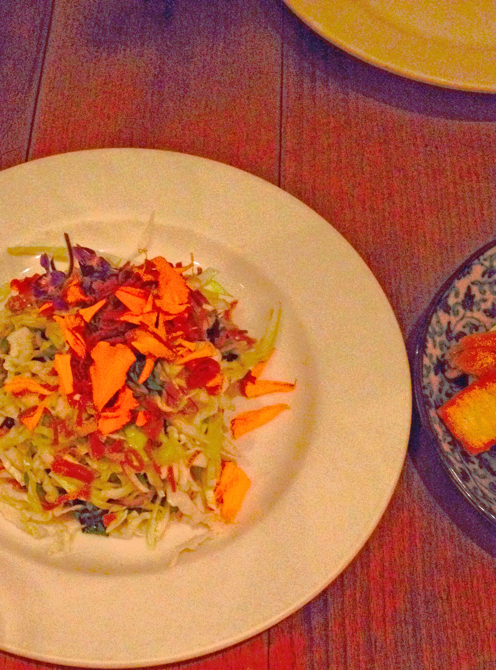Hamachi tostada with herbs, fish sauce vinaigrette, and peanuts.