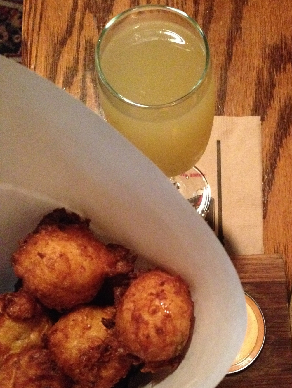SWEET CORN FRITTERS withfresno chili aioli and a SCOTCH LASSIE with famous grouse, apricot and ginger liquor topped with prosecco