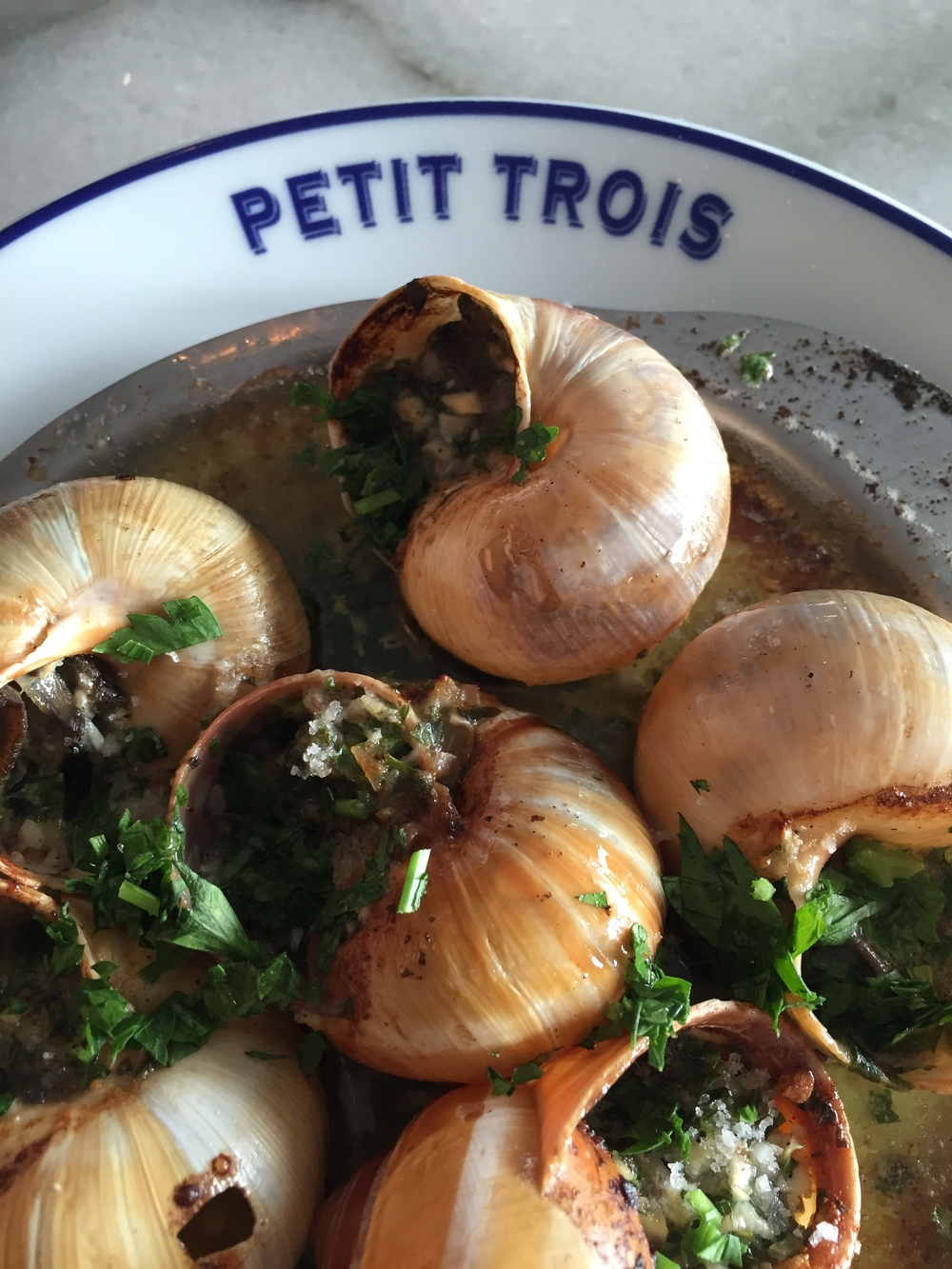 Burgundy Escargots with garlic and parsley butter.