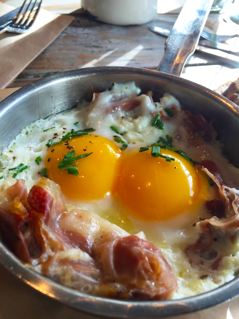 Austrian Speck with Two Sunny Side Eggs in a Pan.