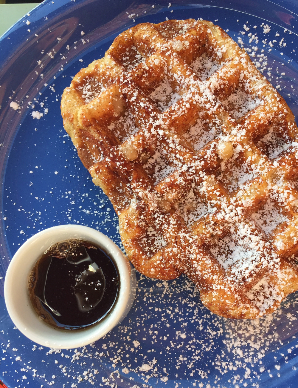 Traditional Liege Waffle coated with Belgium Pearl Sugar and dusted with powdered sugar.